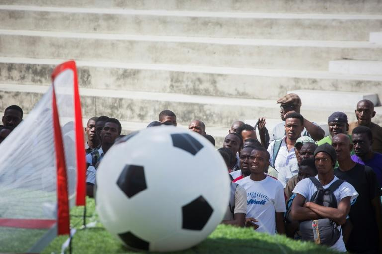 Inflatable balls, artificial turf and the flags of the World Cup teams have been installed around three big screens at the Champ de Mars, the main public square in Port-au-Prince