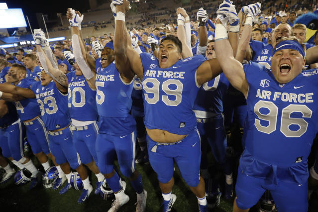 From left to right, Air Force fullback Taven Birdow, wide receiver Benjamin Waters, quarterback Donald Hammond III, defensive linemen Mosese Fifita and Joey Woodring cheer as they conclude singing their school song with other teammates after the second half of an NCAA college football game against Fresno State, Saturday, Oct. 12, 2019, at Air Force Academy, Colo. (AP Photo/David Zalubowski)