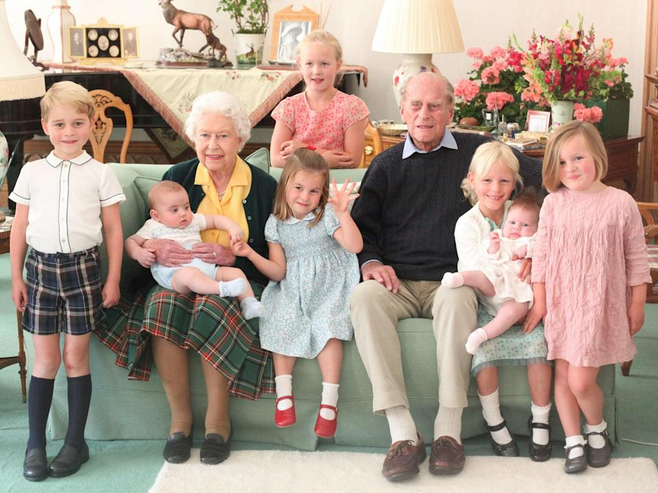 Pictured (left to right) Prince George, Prince Louis being held by Queen Elizabeth II, Savannah Phillips (standing at rear), Princess Charlotte, the Duke of Edinburgh, Isla Phillips holding Lena Tindall, and Mia Tindall.Duchess of Cambridge/PA