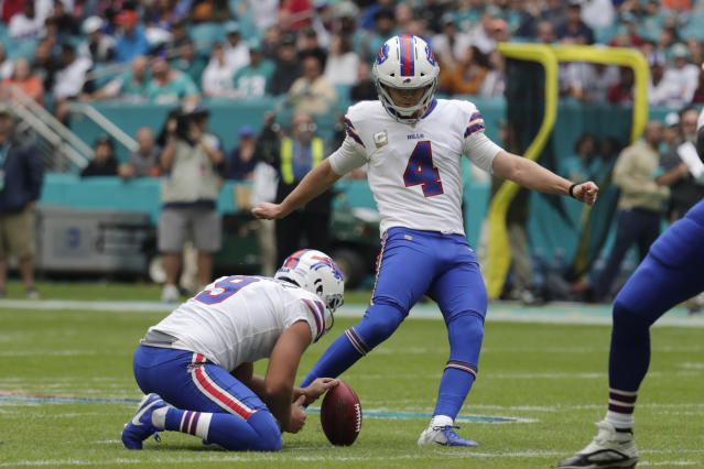 FILE - In this Sunday, Nov. 17, 2019 file photo, Buffalo Bills kicker Stephen Hauschka (4) kicks a field goal, during the first half at an NFL football game against the Miami Dolphins in Miami Gardens, Fla. Buffalo Bills punter Corey Bojorquez (9) holds. Kickers across the NFL are struggling to put the ball between the uprights this season. The 79.7 percent conversion rate is the leagues lowest number since 2003 when kickers hit 79.2 percent and missed 198 field goals. (AP Photo/Lynne Sladky, File)