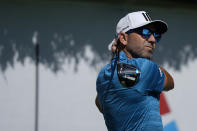 Sergio Garcia hits from the first tee during practice at the Tour Championship golf tournament on Wednesday, Sept. 1, 2021, at East Lake Golf Club in Atlanta. (AP Photo/Brynn Anderson)
