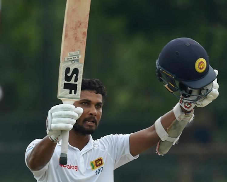 Sri Lanka's Dinesh Chandimal celebrates reaching his century on the second day of the second Test against Bangladesh in Colombo on March 16, 2017