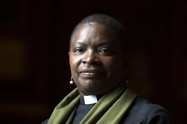 Rose Hudson-Wilkin, chaplain to Queen Elizabeth and the Speaker of the House of Commons, poses for a photograph during an interview with AFP in London on July 9, 2014 (AFP Photo/Carl Court)