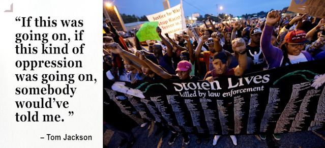 People protest the police shooting death of Michael Brown in Ferguson. (Photo: Charlie Riedel/AP)