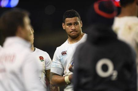 England's Nathan Hughes looks dejected at the end of the match