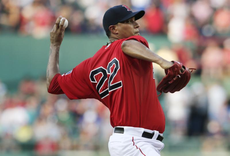 Boston Red Sox starting pitcher Felix Doubront delivers against the New York Yankees during the first inning of a baseball game at Fenway Park, Friday, July 19, 2013, in Boston. (AP Photo/Charles Krupa)