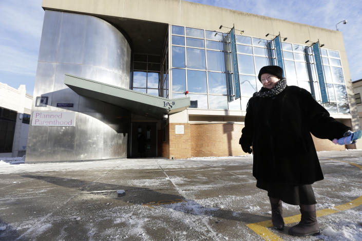This photo taken Dec. 17, 2013 shows anti-abortion protester Eleanor McCullen, of Boston, standing at the painted edge of a buffer zone outside a Planned Parenthood location in Boston. With her pleasant demeanor and grandmotherly mien, McCullen has become the new face of a decades-old fight between abortion opponents asserting their right to try to change the minds of women seeking abortions and abortion providers claiming that patients should be able to enter their facilities without being impeded or harassed. (AP Photo/Steven Senne)