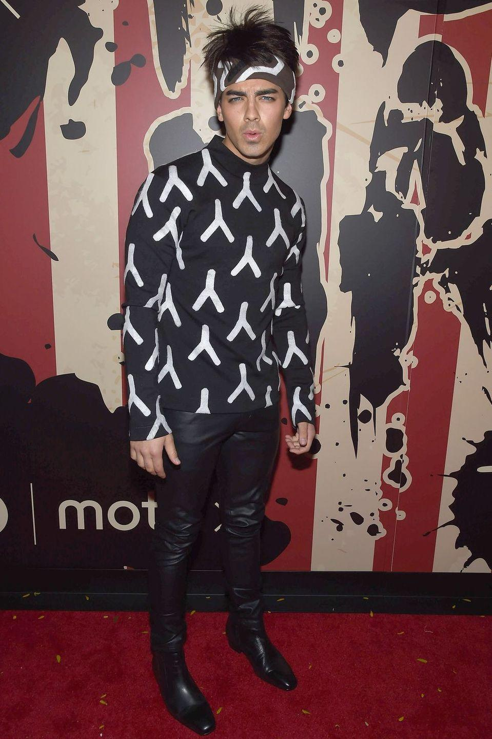 """<p>Tight leather pants, pointy-toed shoes, and some Blue Steel attitude can turn anyone into Derek Zoolander.</p><p><strong>What You'll Need:</strong> <a href=""""https://www.amazon.com/Idopy-Men%60s-Black-Leather-Biker/dp/B01ALS93G2?tag=syn-yahoo-20&ascsubtag=%5Bartid%7C10070.g.28166042%5Bsrc%7Cyahoo-us"""" rel=""""nofollow noopener"""" target=""""_blank"""" data-ylk=""""slk:black leather pants"""" class=""""link rapid-noclick-resp"""">black leather pants</a>, <a href=""""https://www.amazon.com/COOFANDY-Floral-Button-Casual-Hawaiian/dp/B07TTNCNPT?tag=syn-yahoo-20&ascsubtag=%5Bartid%7C10070.g.28166042%5Bsrc%7Cyahoo-us"""" rel=""""nofollow noopener"""" target=""""_blank"""" data-ylk=""""slk:print shirt"""" class=""""link rapid-noclick-resp"""">print shirt</a>, and <a href=""""https://www.amazon.com/Polyester-Feeling-Wrapping-Zinnwaldite-Paisley/dp/B07R7N2PNY?tag=syn-yahoo-20&ascsubtag=%5Bartid%7C10070.g.28166042%5Bsrc%7Cyahoo-us"""" rel=""""nofollow noopener"""" target=""""_blank"""" data-ylk=""""slk:print head scarf"""" class=""""link rapid-noclick-resp"""">print head scarf</a></p>"""