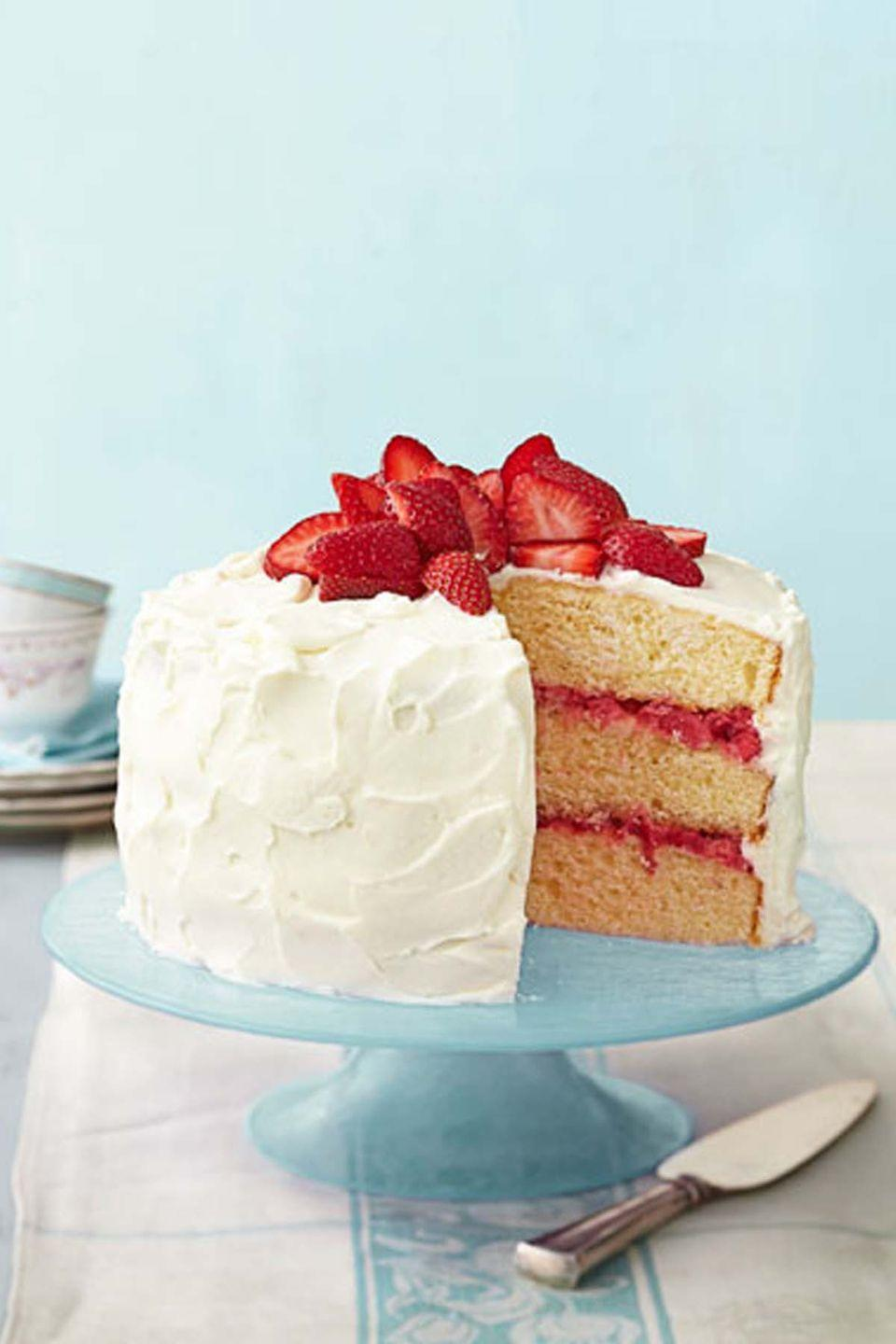 """<p>This treat features layers of fresh strawberry-rhubarb compote and oh-so-sweet cream cheese frosting. </p><p><a href=""""https://www.womansday.com/food-recipes/food-drinks/recipes/a39888/strawberry-rhubarb-layer-cake-recipe-ghk0414/"""" rel=""""nofollow noopener"""" target=""""_blank"""" data-ylk=""""slk:Get the Strawberry Rhubarb Layer Cake recipe."""" class=""""link rapid-noclick-resp""""><strong><em>Get the Strawberry Rhubarb Layer Cake recipe. </em></strong></a></p>"""