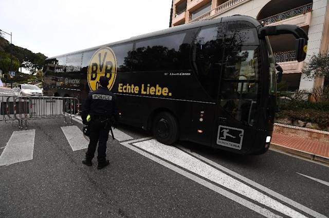 The Dortmund bus arrives under police escort at the Louis II stadium prior to their UEFA Champions League football match against Monaco, on April 19, 2017 (AFP Photo/boris HORVAT )