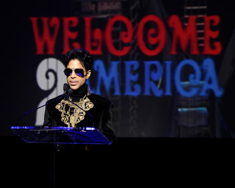 "FILE - In this Oct. 14, 2010 file photo, musician Prince holds a news conference at The Apollo Theater announcing his ""Welcome 2 America"" tour in New York. Prince turns off the lights at South by Southwest on Saturday night, Match 16, 2013, with an unexpected and intimate showcase that ranks among the biggest surprises in years at the star-studded music festival and conference. (AP Photo/Peter Kramer, File)"