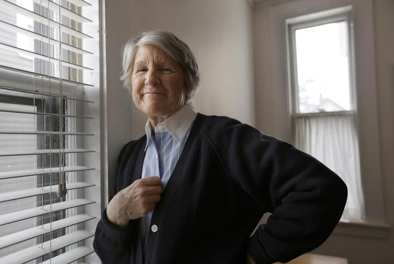 In this March 27, 2013 photo, Cassie Quinlan, 69, poses for a photo in her Concord, Mass., home. Almost 40 years ago, Quinlan drove one of the Boston public school buses that took black students from the city's Roxbury neighborhood to a predominantly white high school in Charlestown. She said that dozens of white protesters would line the curb and police would have to make a wall at the bus door so black students could get into school. Quinlan said her experiences opened her own eyes to black culture, and she became the first white member of a black gospel choir at a local university. (AP Photo/Steven Senne)