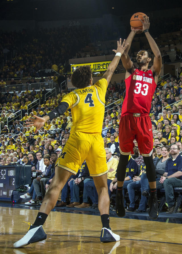 Michigan forward Isaiah Livers (4) defends against a three-point basket-attempt from Ohio State forward Keita Bates-Diop (33) in the first half of an NCAA college basketball game at Crisler Center in Ann Arbor, Mich., Sunday, Feb. 18, 2018. (AP Photo/Tony Ding)