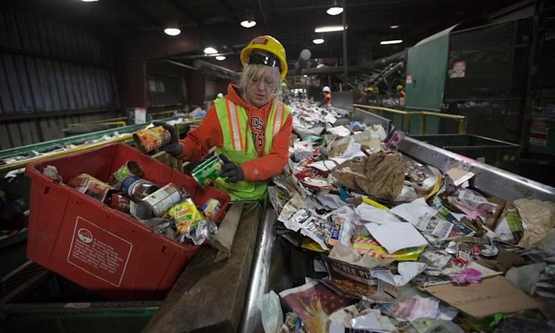 Sorting paper and plastic waste in Oregon, US