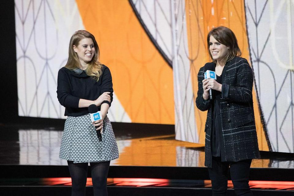 Princesses Beatrice and Eugenie also spend their free time working for charities such as WE Day – an organisation which celebrates young people making a difference in their local community [Photo: Getty]