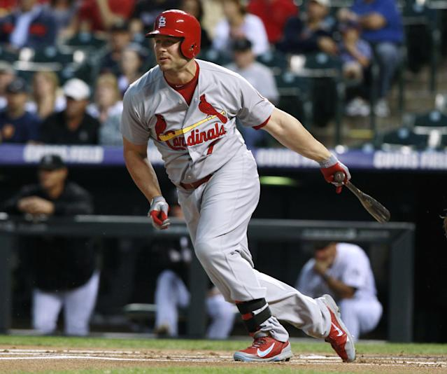 St. Louis Cardinals' Matt Holliday grounds out against the Colorado Rockies to close the top of the first inning of a baseball game in Denver on Wednesday, Sept. 18, 2013. (AP Photo/David Zalubowski)