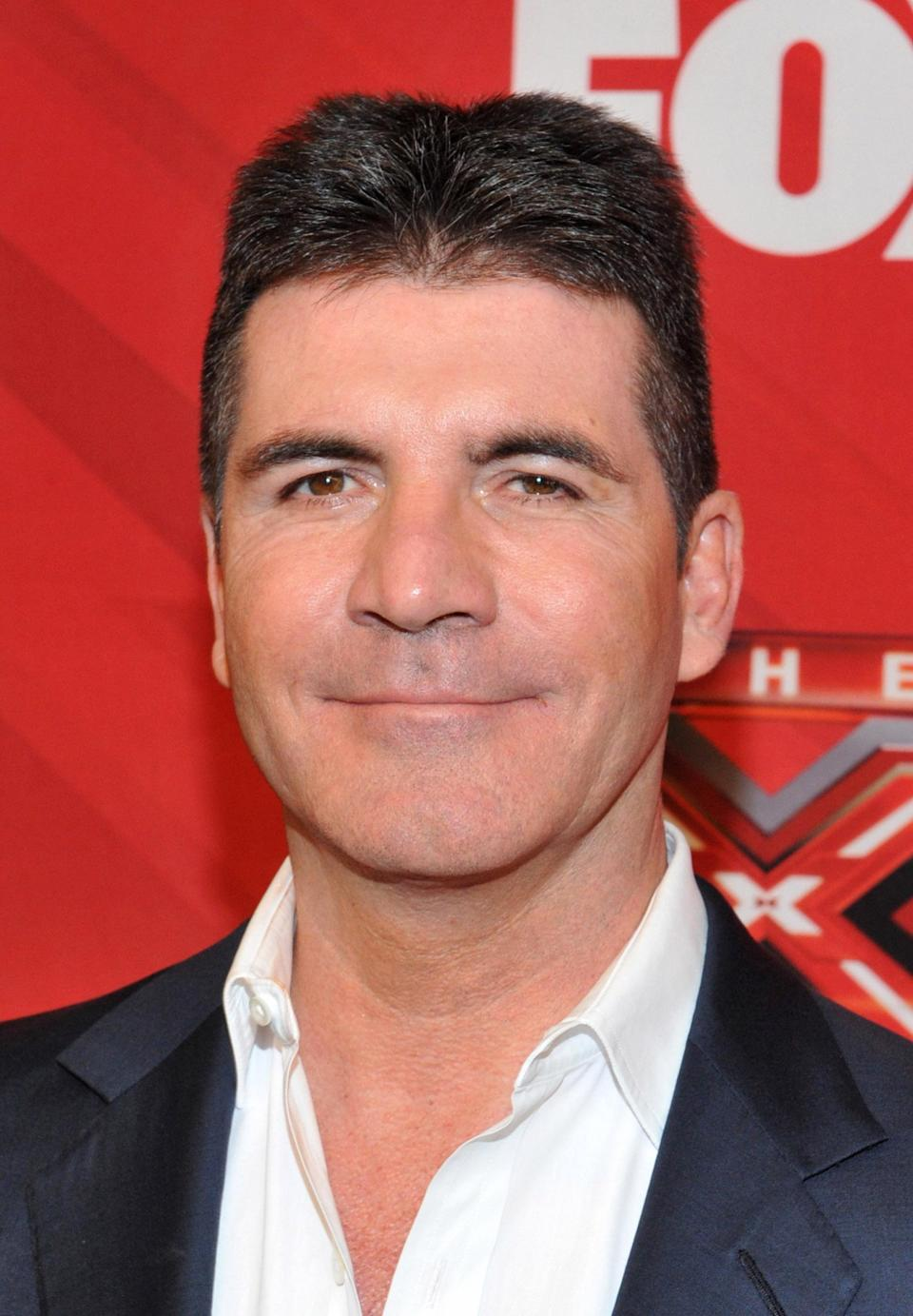 """<div class=""""caption-credit""""> Photo by: (Photo by Mark Davis/Getty Images)</div>""""To me, Botox is no more unusual than toothpaste,"""" Simon Cowell admitted to <i>Glamour Magazine</i>. """"It works, you do it once a year - who cares?"""""""