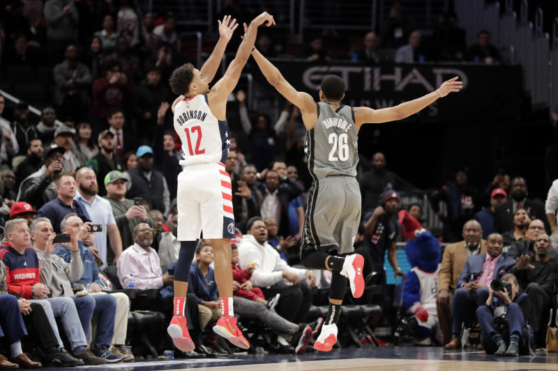 Washington Wizards' Jerome Robinson (12) shoots over Brooklyn Nets' Spencer Dinwiddie (26) during the fourth quarter of an NBA basketball game Wednesday, Feb. 26, 2020, in Washington. The Wizards won 110-106. (AP Photo/Luis M. Alvarez)