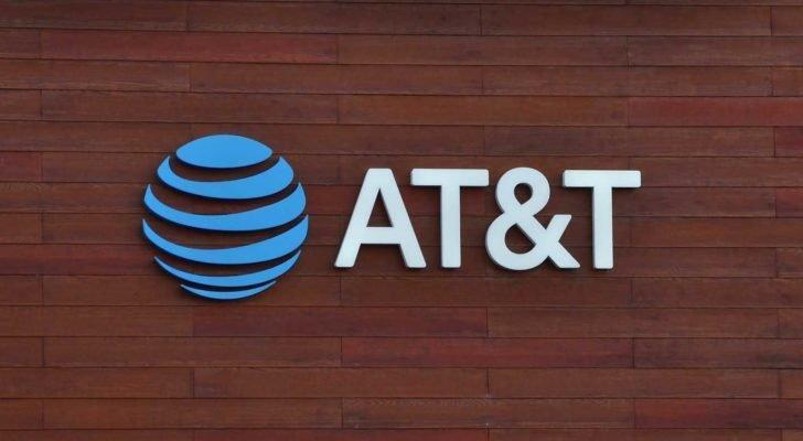 AT&T (T) logo on wooden background