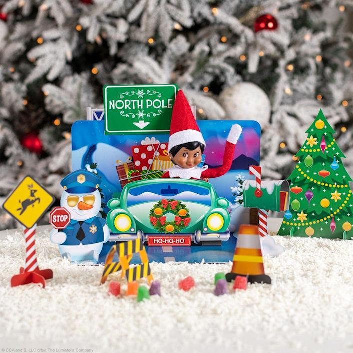 """<p>Your Elf will be cruising back into your home in style with the help of a similarly hilarious backdrop. Of course, if you don't have time to fashion a vibrant scene like this one, you can always use a small toy car instead.</p><p><strong>Get the tutorial at <a href=""""https://elfontheshelf.com/elf-ideas/looked-who-popped-by/"""" rel=""""nofollow noopener"""" target=""""_blank"""" data-ylk=""""slk:Elf on the Shelf"""" class=""""link rapid-noclick-resp"""">Elf on the Shelf</a>.</strong></p>"""