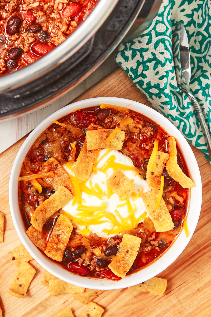 """<p>If there's one thing the Instant Pot does well, it's chilli. The pot takes away all of the legwork of standing and stirring over the stove for forever. And it's so flavourful! Swap in different beans or use minced turkey instead. It will all come out delicious!</p><p>Get the <a href=""""https://www.delish.com/uk/cooking/recipes/a30208142/instant-pot-chili-recipe/"""" rel=""""nofollow noopener"""" target=""""_blank"""" data-ylk=""""slk:Instant Pot Chilli"""" class=""""link rapid-noclick-resp"""">Instant Pot Chilli</a> recipe.</p>"""
