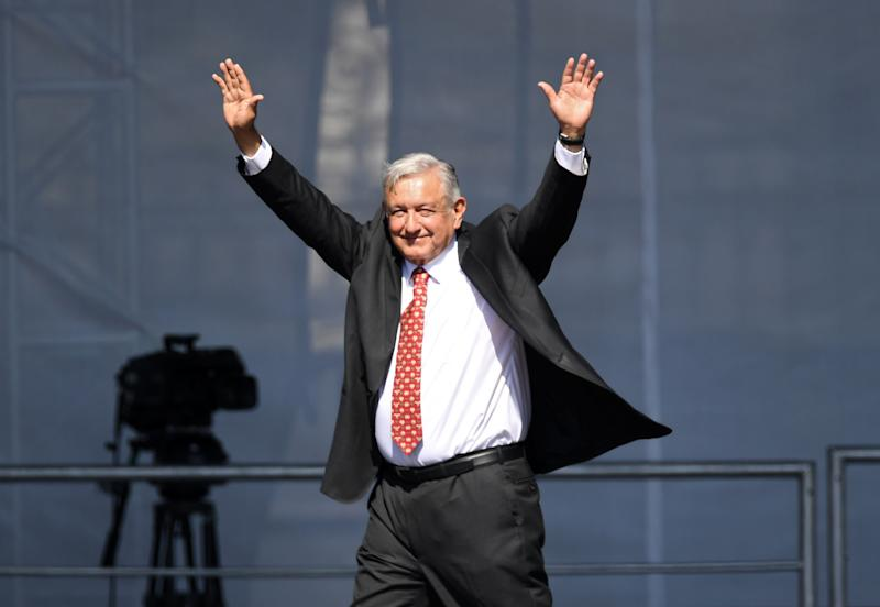 Mexican President Andres Manuel Lopez Obrador waves during a rally marking his first year in office at the Zocalo square in Mexico City on December 1, 2019. (Photo by PEDRO PARDO / AFP) (Photo by PEDRO PARDO/AFP via Getty Images)