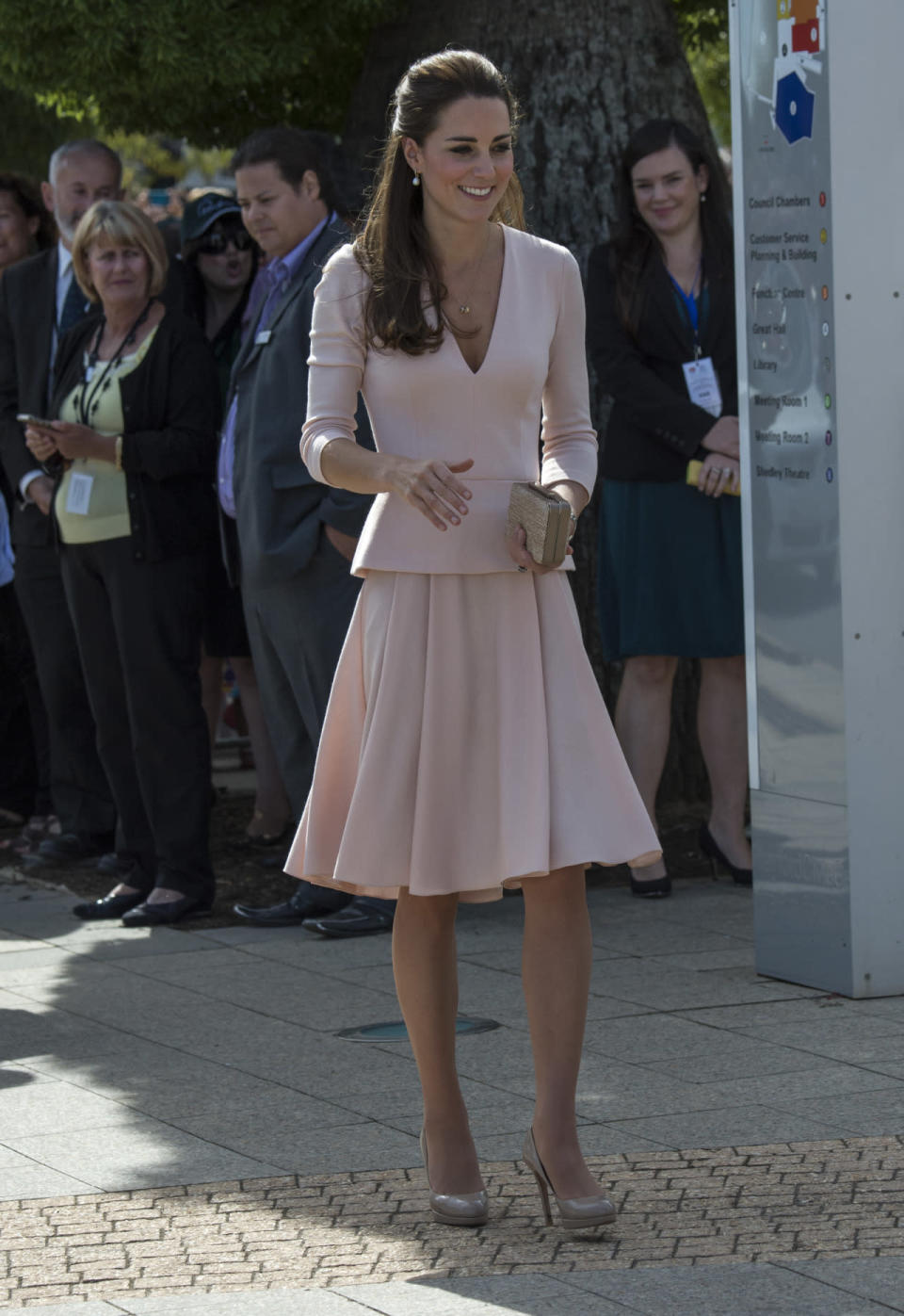 <p>Kate visited an Australian youth centre in a soft pink ensemble by Alexander McQueen. She accessorised with nude L.K. Bennett shoes and clutch.</p><p><i>[Photo: PA]</i></p>