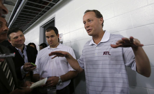 Atlanta Hawks coach Mike Budenholzer gestures as he talks to reporters before the Hawks' NBA preseason basketball game against the Miami Heat, Monday, Oct. 7, 2013, in Miami. (AP Photo/Alan Diaz)