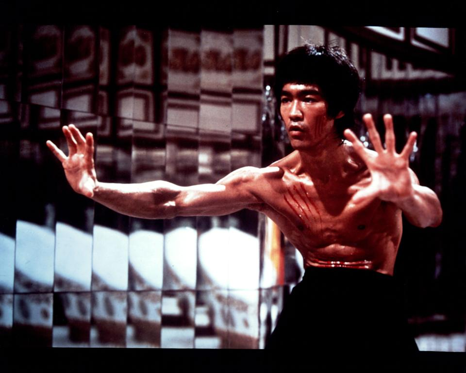 Bruce Lee with fresh scratch marks on his face and chest in a scene from the film 'Enter The Dragon', 1973. (Photo by Warner Brothers/Getty Images)