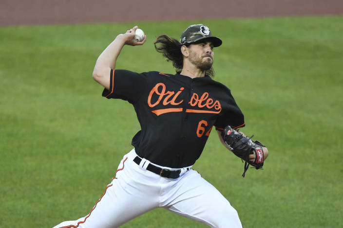 Baltimore Orioles starting pitcher Dean Kremer throws during the first inning of a baseball game against the New York Yankees on Friday, May 14, 2021, in Baltimore. (AP Photo/Terrance Williams)