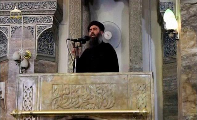 The alleged first public appearance of Abu Bakr al-Baghdadi, the reclusive leader of ISIS, held at the al-Nuri mosque in Mosul, Iraq, July 5, 2014, in a still image taken from video. (Photo: via Reuters TV)
