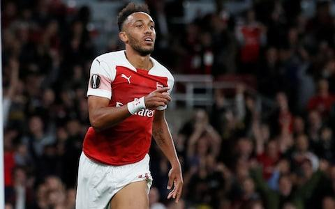 Arsenal's Pierre-Emerick celebrates scoring their first goal - Credit:  REUTERS/David Klein