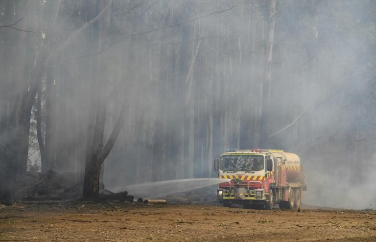 Firefighters have fanned out across the region, tackling hundreds of blazes (AFP Photo/WILLIAM WEST)