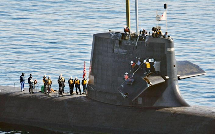 Japanese Maritime Self-Defense Force submarine Souryu off Kochi port in the western Japan main island of Shikoku on Feb. 9, 2021, following its collision with a commercial vessel in the Pacific Ocean off Shikoku the previous da - Kyodo/Newscom / Newscom