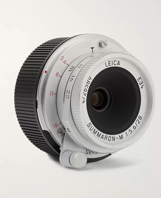 """<p><strong>Leica</strong></p><p>mrporter.com</p><p><strong>$2595.00</strong></p><p><a href=""""https://go.skimresources.com?id=74968X1525079&xs=1&url=https%3A%2F%2Fwww.mrporter.com%2Fen-us%2Fmens%2Fproduct%2Fleica%2Flifestyle%2Flenses%2Fsummaron-m-28-mm-f56-camera-lens%2F2944798053770631"""" rel=""""nofollow noopener"""" target=""""_blank"""" data-ylk=""""slk:Shop Now"""" class=""""link rapid-noclick-resp"""">Shop Now</a></p><p>Make sure he doesn't miss any of life's moments by giving him a new lens for his camera. Its compact, yet highly technical, design allows him to take it with him everywhere to capture every detail.</p>"""