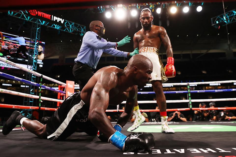 Chad Johnson is knocked down by Brian Maxwell during their contracted exhibition boxing match at Hard Rock Stadium on June 06, 2021.