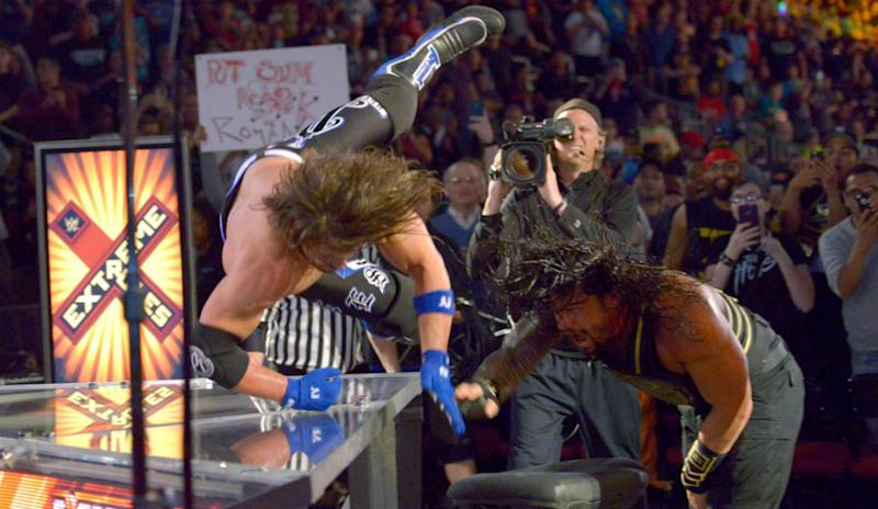 Reigns tosses Styles