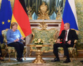 German Chancellor Angela Merkel, left, and Russian President Vladimir Putin talk during their meeting in the Kremlin in Moscow, Russia, Friday, Aug. 20, 2021. The talks between Merkel and Putin are expected to focus on Afghanistan, the Ukrainian crisis and the situation in Belarus among other issues. (Evgeny Odinokov, Sputnik, Kremlin Pool Photo via AP)