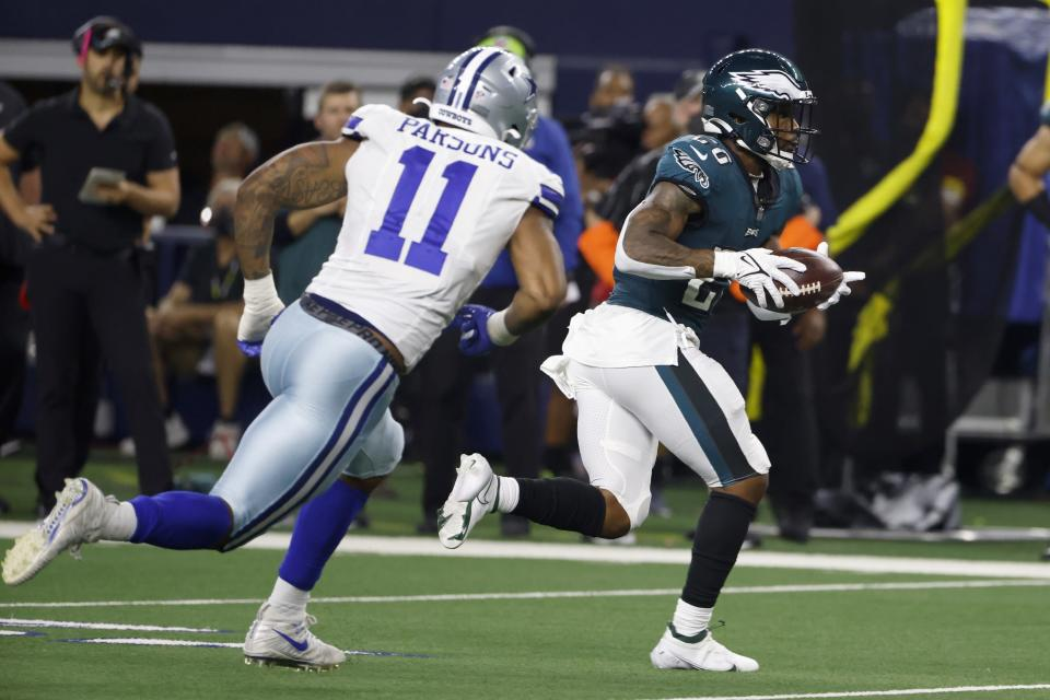 Dallas Cowboys linebacker Micah Parsons (11) gives chase as Philadelphia Eagles running back Miles Sanders (26) gains yardage after catching a pass in the second half of an NFL football game in Arlington, Texas, Monday, Sept. 27, 2021. (AP Photo/Ron Jenkins)