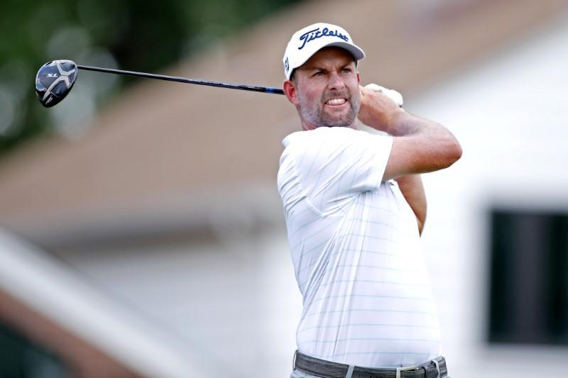 Golf: Simpson in share of lead at halfway point in Detroit