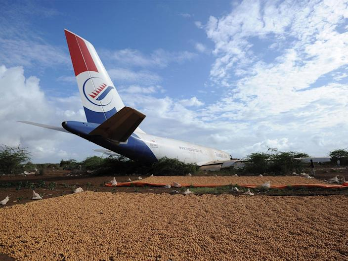 The wreckage of cargo plane carrying supplies for peacekeeping force troops after the crash outside Somalia's capital, on October 13, 2015 (AFP via Getty Images)