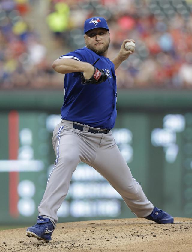 Toronto Blue Jays starting pitcher Mark Buehrle throws during the first inning of a baseball game against the Texas Rangers Friday, June 14, 2013, in Arlington, Texas. (AP Photo/LM Otero)