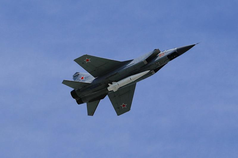 A MiG-31K fighter jets with Kinzhal hypersonic missiles fly over Moscow's Red Square during the Victory Day military.