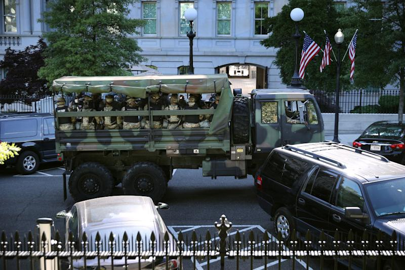 Trucks transport District of Columbia National Guard troops in Washington. Source: Getty
