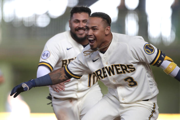Milwaukee Brewers' Orlando Arcia celebrates with teammates after driving in the winning run during the 10th inning of the team's opening-day baseball game against the Minnesota Twins on Thursday, April 1, 2021, in Milwaukee. (AP Photo/Aaron Gash)