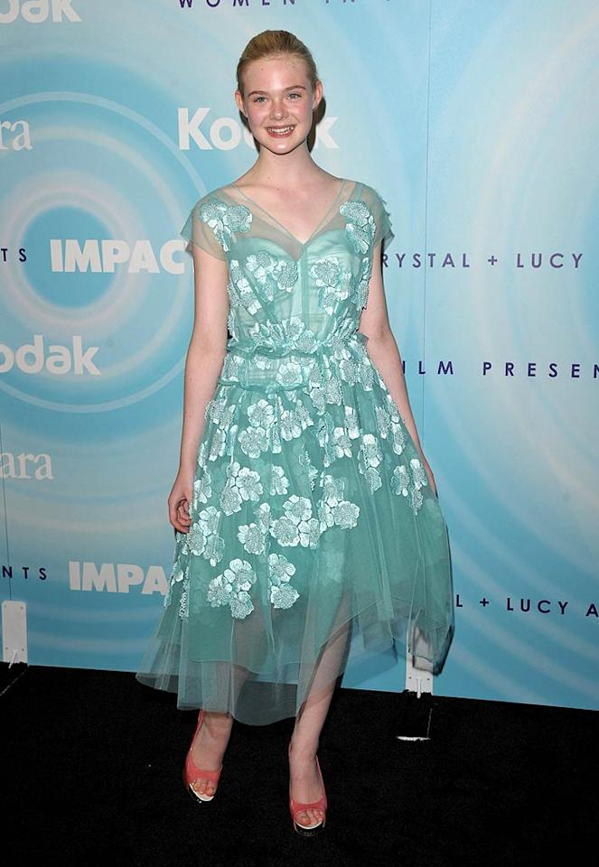 "Dakota's little sis, 13-year-old ""Super 8"" star Elle Fanning, looked all grown up in her floral Marc Jacobs frock. John Shearer/<a href=""http://www.gettyimages.com/"" target=""new"">GettyImages.com</a> - June 16, 2011"