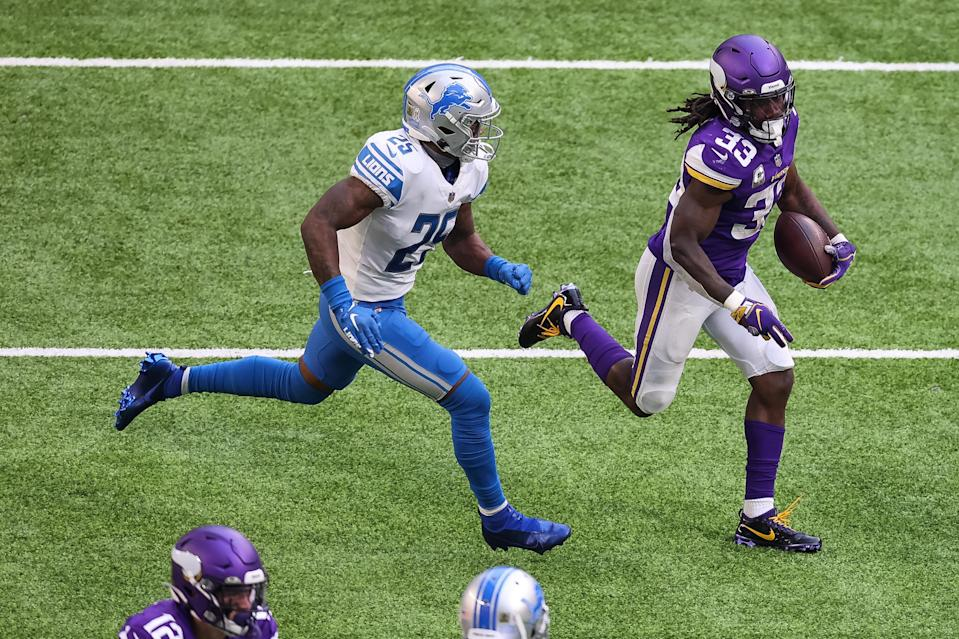 Minnesota Vikings running back Dalvin Cook runs the ball against Detroit Lions safety Will Harris during the second quarter at U.S. Bank Stadium, Nov. 8, 2020.