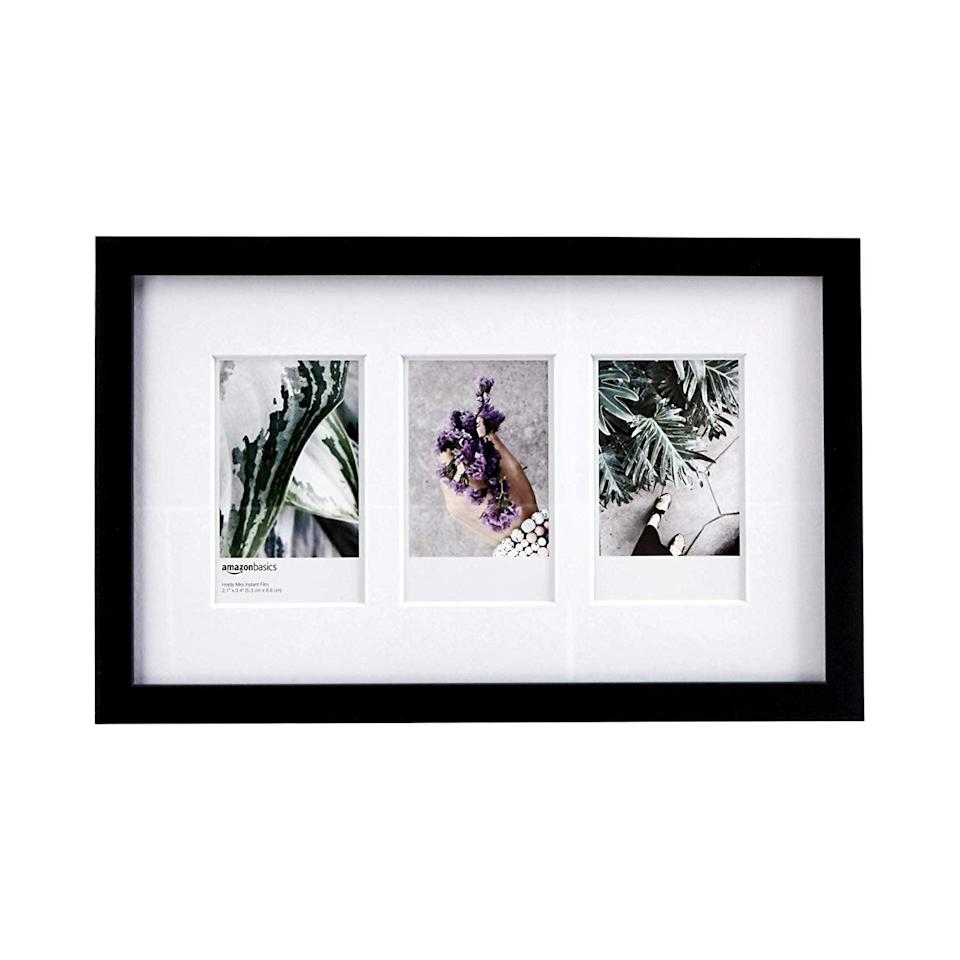 """Even though a polaroid has a built-in frame, sometimes you want a frame for your frame. <br><br><strong>AmazonBasics</strong> AmazonBasics Photo Frame, $, available at <a href=""""https://www.amazon.com/AmazonBasics-Photo-Frame-use-Instax/dp/B07RFQY8TB/"""" rel=""""nofollow noopener"""" target=""""_blank"""" data-ylk=""""slk:Amazon"""" class=""""link rapid-noclick-resp"""">Amazon</a>"""