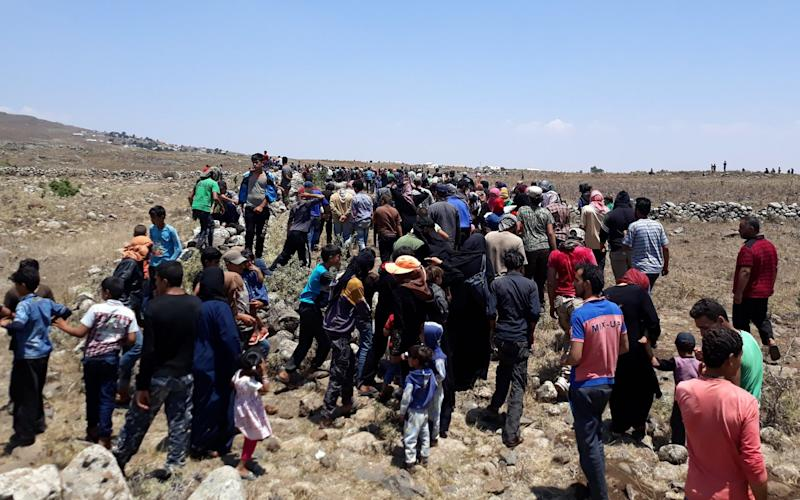 Approximately 200 civil Syrians who fled from the Assad regime's strikes over Daraa and Quneitra districts, are close to occupied Golan Heights near Israeli Border in Daraa - Anadolu
