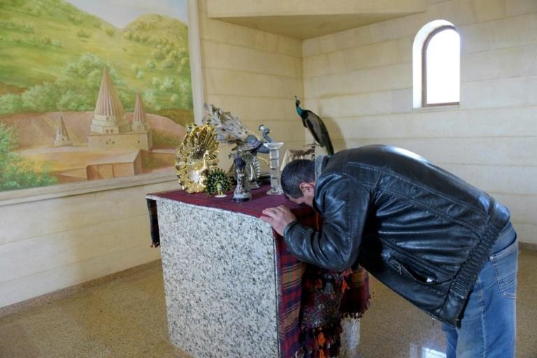 Misha Davrshyan at prayer -- the Yazidis hold unique beliefs that have integrated elements of Judaism, Christianity and Islam